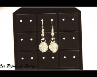 Earring with its transparent crackled bead cage