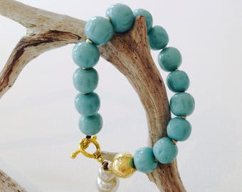 Faith (3) turquoise bead and gold bracelet.