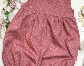 Pretty in Pink. floral romper. For babies and toddlers 0-4 years.