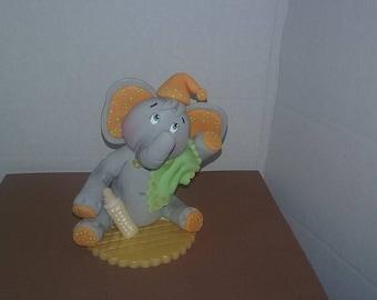 Baby elephant with blanket