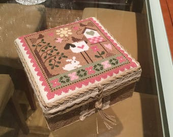 Box decorated with embroidery
