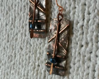 Folded copper rectangle earrings with blue glass beads
