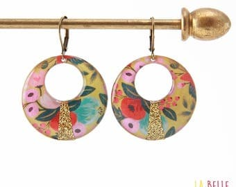 Resin earrings round floral on mustard yellow background and glitter