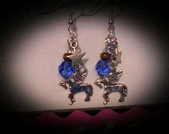 Pegasus earrings sliver charms w/blue bead accents.