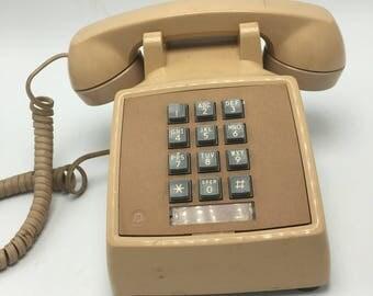 Vintage Western Electric push button desk phone. Nice tan color