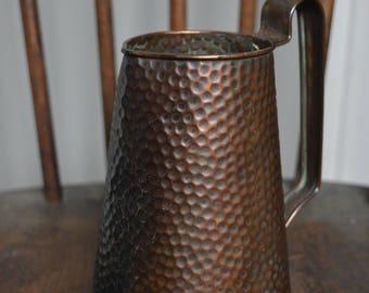 Hammered copper water jug
