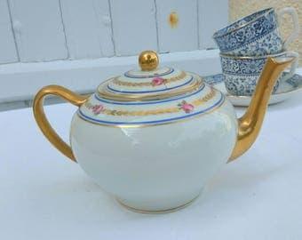 Vintage French Limoges porcelain tea pot, hand painted rosebuds, gold trim. A Giraud.