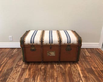 Vintage steamer trunk with French grain sack top.