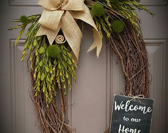 """Sophisticated Welcome 24"""" Oval Grapevine Wreath"""