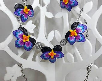 Blue and pink orchids in polymer clay steampunk finery.