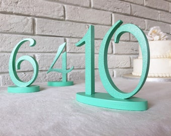 Wood table numbers for a wedding, annyversary, birthday party, or any event. Numbers in Mint with silver glitter, Silver, Gold, or any color