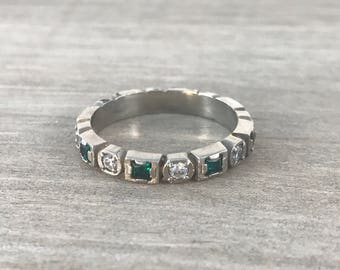 Synthetic emerald eternity band in white gold