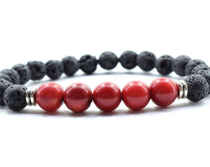 Women's Bracelet with Red Coral and Black Lava stone beads.