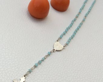 Beautiful French Childs Rosary in an Oval Shaped Lucite Case.