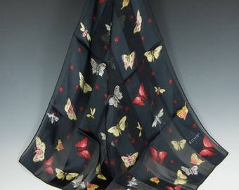 Black magic ECHO foulard scarf in sheer and satiny black stripes with moth and butterfly motif in colors.