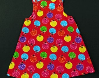 Colored apples on red Jumper dress