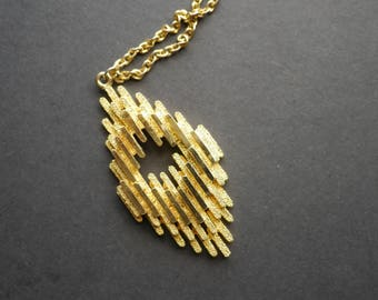 1970s modernist abstract gold tone metal textured pendant on chain