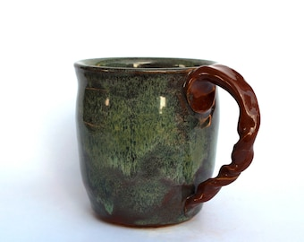 Green frosted mug with a twisted handle