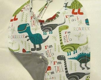 Cartoon Dinosaurs! Baby Bib. Grey Reversible Backing. 100% Cotton. Handmade. Roar!