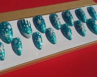 Snowflakes on Turquois Stiletto Press On Nails Medium Length Set of 20 | No. 299