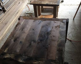 Reclaimed wood coffee tables made ftom the wood of a one hundred year old barn.