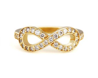 "18k yellow gold diamond ""infinity"" ring"