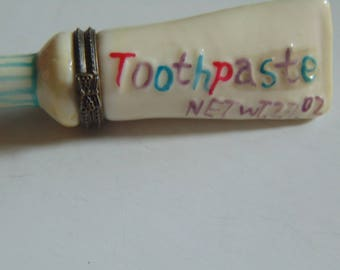 Toothpaste tube with toothbrush trinket box box.