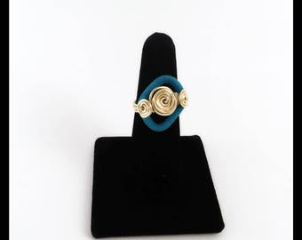 Geometrical Wired Ring With Gold And Turqouise Velveteen. Gold Tone Spiraled Ring With Turqouise Velveteen. Blue and Gold Wired Ring