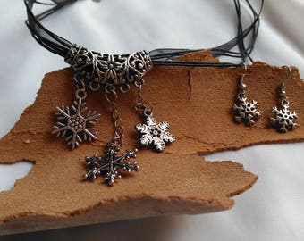Set of necklace and earrings of snowflakes. Winter