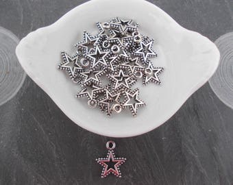 Star shaped charm in silver