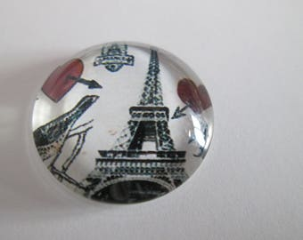 a round 20 mm printed Eiffel Tower glass cabochon