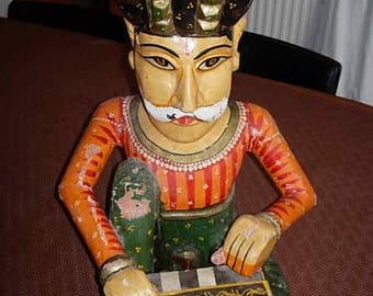 carved and painted indian figure