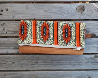 Clutch in natural leather and African fabric orange background and yellow flowers