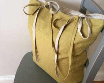 Olive and natural linen cushion with ties.