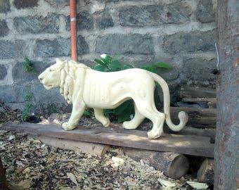 A Handmade Jacaranda Lion