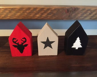 Red wooden block house with black stags head