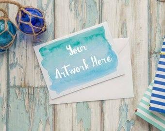 White A6 Card Mockup - blue weathered wood background