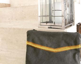Khaki pouch and tassel trim