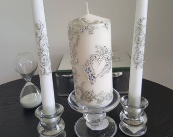 """Union candles, set of three, one soft white pillar 6"""" tall and two whiter taper candles 10"""" tall, hand painted, very unique."""