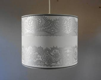 Lamp shade or cylindrical hanging decor slightly silver gray lace print.