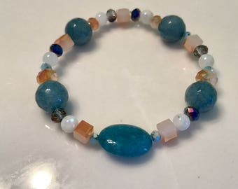 Relief from emotional stress -calming , freedom of Exspression, serenity , & soothing - aquamarine , moonstone
