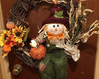 Fall scarecrow and pumpkin wreath