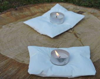 a white cushion concrete candle holder