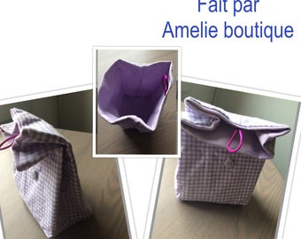 Purple gingham fabric bag lined with button