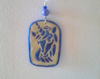rectangular pendant with a Unicorn head fluorescent