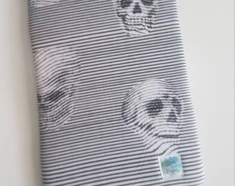 Striped skulls book sleeve