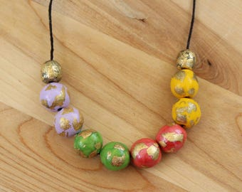 Multicolored necklace, colorful bead jewelry handmade with polymer clay and gold metal flakes