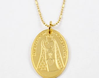 Gold chain with Virgin Mary charm