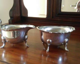 Cream jug and sugar bowl.