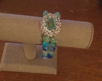 Double  beaded Blue  and  green round glass beaded bracelet with a slider.